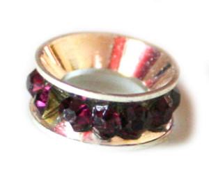Fuchia colored rhinestones set in rondelle. Silver base colour. 12mm -0