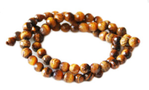 Tiger Eye bead string, round, faceted, 6mm, 40cm