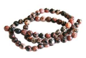 Red snowflake jasper bead string, round, faceted, 6mm, 40cm